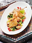 Quail on a leek and mushroom medley with pomegranate seeds