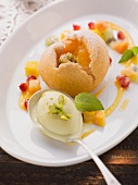 Baked medlars with fruit salad and pistachio ice cream