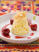 Couscous and saffron cream with cherries