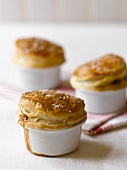 Pies with puff pastry lids