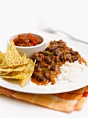 Chilli con carne with rice and tortilla chips