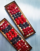 Tarts topped with fresh berries
