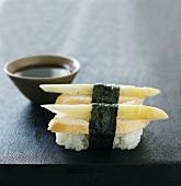 Nigiri sushi with chicken and white asparagus