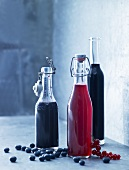 Homemade juices (blueberry juice and redcurrant juice) in flip-top bottles