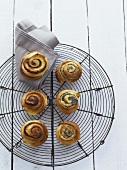 Cinnamon and poppy seed pastries on a wire rack