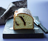 A Scandinavian loaf cake with a cinnamon filling and icing sugar