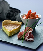 Potato cakes with raw ham and tomato salad