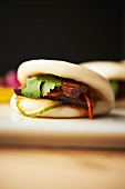 Steamed Chinese Bun with Pork Belly, Cilantro and Chili Pepper