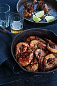 Pan Fried Shrimp with Jalapeno, Garlic and Lime; Glass of Beer