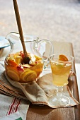 White Sangria in a Pitcher with a Wooden Spoon and In a Glass