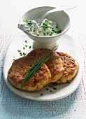 Spicy lentil and peanut butter cakes with chive quark