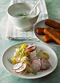 Radish and potato salad with fish fingers