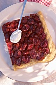 A slice of damson tart