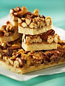 A stack of nut bars with caramel