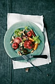Colourful tomato salad with almonds
