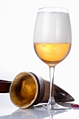 A glass of beer and a drinking horn