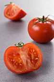 Tomatoes, whole, halved and quartered
