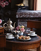 A table laid with macaroons and tea