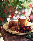 Sponge cake slices with berries and cream (Savoyen)