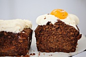 Carrot cake topped with cream cheese and mandarins