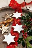 Cinnamon stars, sprigs of holly, cinnamon stick and wooden stars