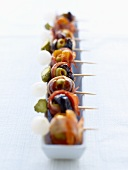 Olives, bacon and gherkins on sticks