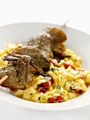 Lamb kebab on scrambled egg