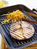 Grilled sword fish steak with julienned vegetables