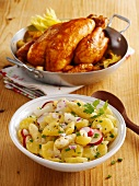 Potato salad with asparagus, radishes and roast chicken
