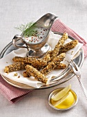 White asparagus in a spicy sesame coating and a yogurt dip