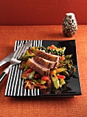 Roast duck breast on a sweet and sour asparagus medley