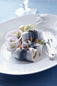 Herring rolls with onions and potatoes