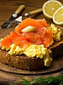 Wholemeal bread topped with smoked salmon and scrambled egg