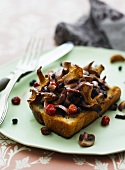 Toast topped with mushrooms and cranberries