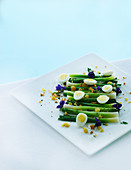 Spring onions with egg and edible flowers