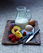 An arrangement of milk, eggs, fruit and vanilla pods
