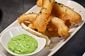 Battered sole strips with mushy mint peas