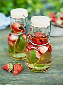 Homemade strawberry vinegar with basil