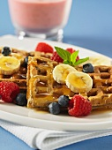 Pecan nut waffles with bananas, blueberries, raspberries and maple syrup