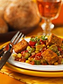 Cajun tofu on a bed of vegetables (okra, tomatoes and sweetcorn)