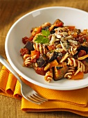 Fusilli pasta with an aubergine and pepper sauce and almonds