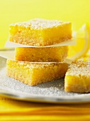A stack of lemon slices dusted with icing sugar
