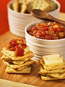 Crackers with tomato and apple chutney and cheese