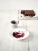Brownies with cherries (leftovers on a plate)