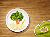A tree of peas with mashed potatoes (children's meal)