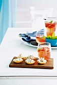 Prawn and dill tartlets and a fizzy strawberry drink