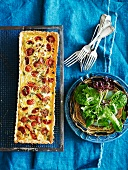 Tomato and goat's cheese tart with a mixed leaf salad