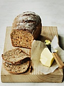 Wholemeal bread and butter on an old chopping board