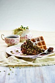 French Toast with Chocolate Hazelnut Spread and Pistachios Dusted with Powdered Sugar; Cup of Coffee
