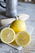 A whole lemon and a halved lemon
